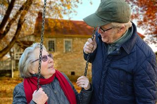 Older Couple on Swing